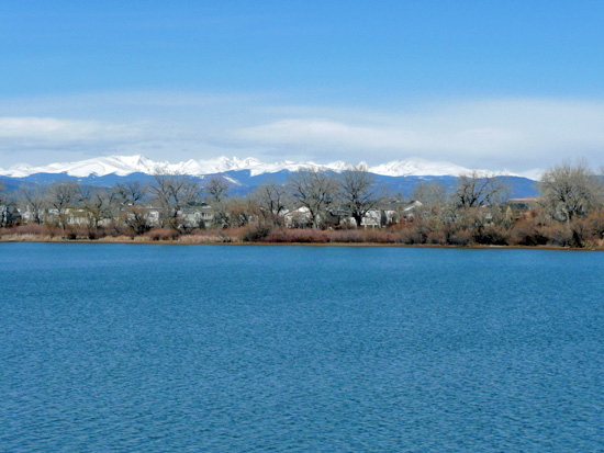 The snowcapped Indian Peaks provide a striking backdrop to Waneka Lake